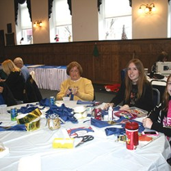 Making blue ribbons that will be made available for the public to show in support of police are Upland residents Christy Mason, Nancy Stine, Kate and Sara Mason.
