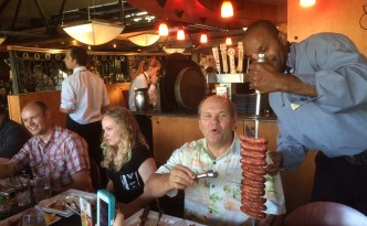 """""""Gaucho"""" servers come to your table and carve grilled meats from a skewer onto your plate."""