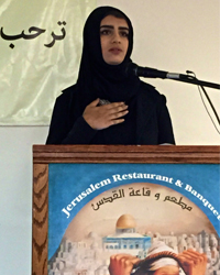 Manar Daghash reading her poetry (Photo by Bill Chambers)