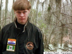 Dylann Roof with Apartheid-era South African and White-Rule Rhodesia flags on his jacket.