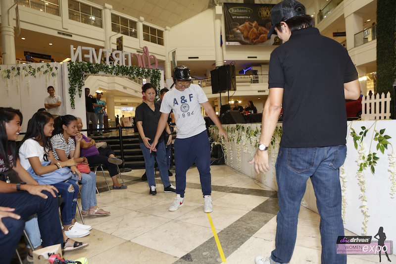a-participant-trying-on-the-beer-goggles-during-the-raod-safety-semianar-presented-by-mazda