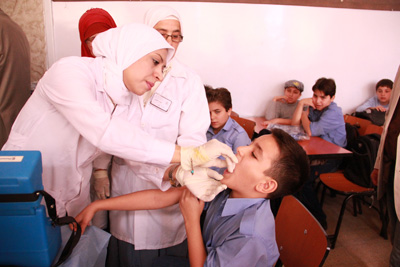 A sixth grade boy at a Damascus school gets booster Vitamin A, having just received an MMR vaccination during a UNICEF-supported vaccination campaign. © UNICEF/Syria-2013/Rashidi