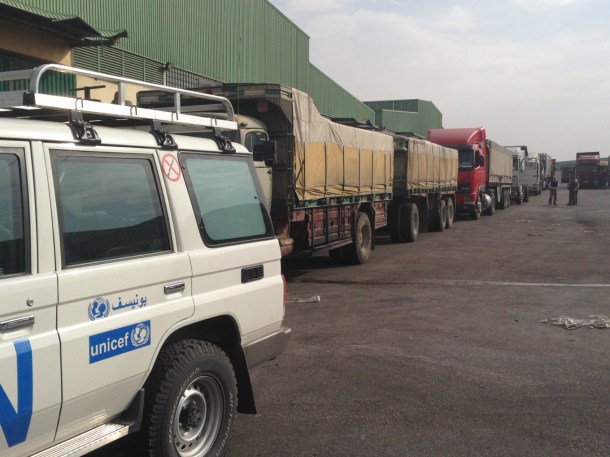 UN supply trucks leave warehouse