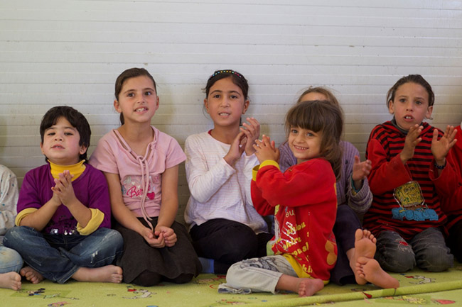 Six-year-old Safa (in red) plays at a UNICEF/Save the Children child friendly space in the Za'atari refugee camp. ©UNICEF/Jordan-2013/Noorani