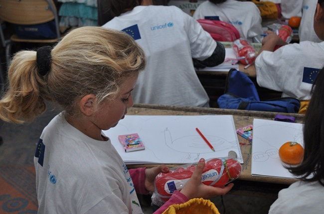A small girl joins a painting class to commemorate World Water Day, at the Arbat Syrian refugee camp in Kurdistan, Iraq.