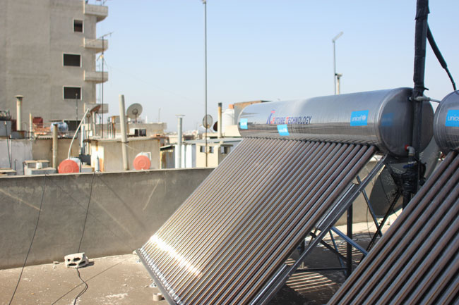 The UNICEF-supported solar water heater helps ensure every family has reliable access to hot water for bathing and cleaning needs.                                                                                    © UNICEF/Syria-2014/Rashidi