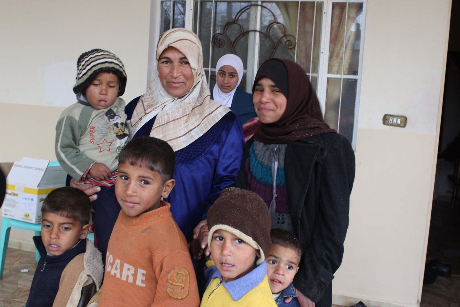 Oum Hani and her family wait in the queue at the mobile vaccination unit