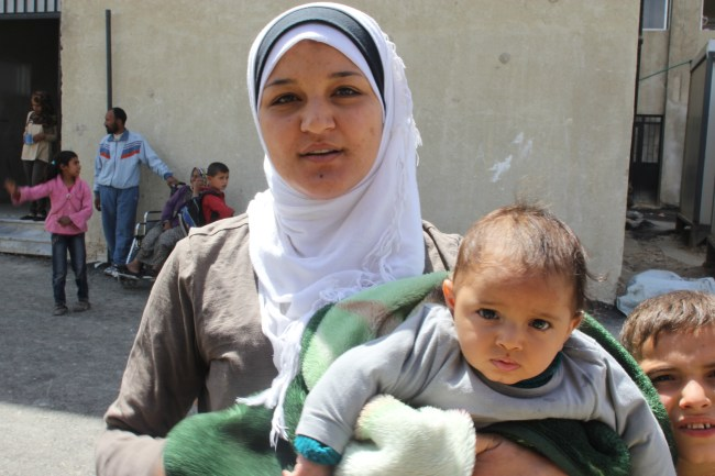 A mother with her baby girl outside the health centre