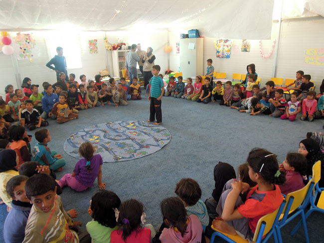 Children participate in activities at a 'Child Friendly Space' in Azraq refugee camp. ©UNICEF/Jordan-2014/Fricker