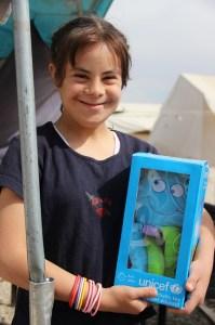 Nour holds her new toy. ©UNICEF/Turkey-2014/Yurtsever