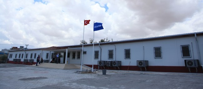One of 14 UNICEF-supported pre-fabricated school in Kilis. This one has 12 classrooms and offers education to Syrian children living in non-camps settings. ©UNICEF/Turkey-2014/ FEYZIOGLU