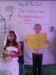 Young girls act out an early marriage scenario.