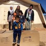 أطفال سوريا في الأردن يستلمون ملابس الشتاء