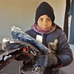 Syrian children in Jordan receive warm clothes for winter