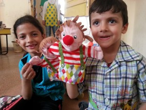 Rokan (6) and brother Mahmoud (5) enjoy playing with IKEA hand puppets that are part of an IKEA ECD kit newly delivered to Ahlam Al-Tofoola kindergarten in Tartous city.