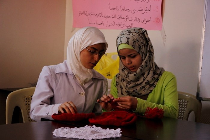 © UNICEF/2016/Kassem Douaa, 18, (right) and her trainer Soumaia at a UNICEF supported vocational and life skills centre in the central governorate of Homs.