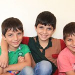 Happy and ready to go back to school in Jordan: The story of 3 Syrian brothers