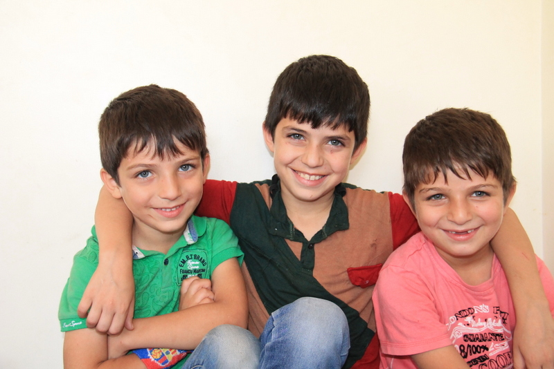 Syrian brothers Hamzah, Bakr and Abdul are really excited to start school again in Jordan.  Photo: unicef/2016/abedelMajeed