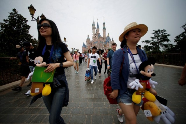 People walk at Shanghai Disney Resort during a three-day Grand Opening event in Shanghai, China, June 15, 2016. REUTERS/Aly Song