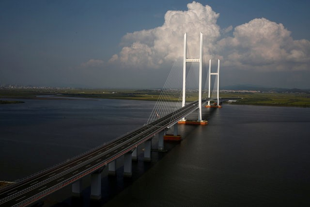 A general view shows the unfinished New Yalu River bridge that was designed to connect China's Dandong New Zone, Liaoning province, and North Korea's Sinuiju, September 11, 2016. REUTERS/Thomas Peter
