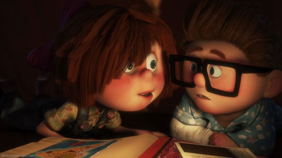 Young Ellie reads to Carl from her Adventure Book  in an early scene from Pixar's 'Up.'