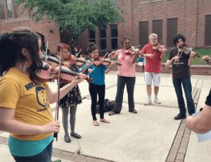 playing outside at violin summer camp