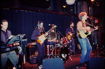 Christopher and his band at the New Music Cafe NYC in the mid-1990's. L to R: John Bauers, keyboard; Dave phelps, lead guitar; Joe Damone, drums; Peter Brown, bass; Rozz Morehead, backup vocals (not pictured). —Photo by Andrew Peglassy