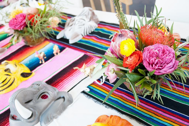 animal masks and flowers at fiesta party