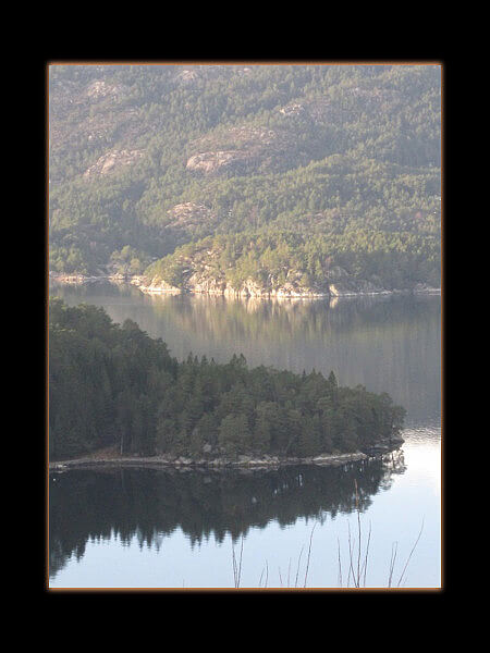 Wordless Wednesday: sun and shadow fjord reflections