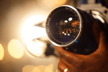 About the irradiance and apertures of camera lenses