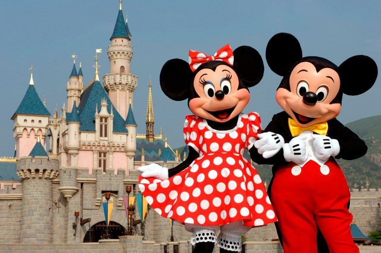 In this photo released by Hong Kong Disneyland, Disney characters Mickey Mouse and Minnie Mouse pose in front of the Sleeping Beauty Castle in Hong Kong's Disneyland Park Thursday, Sept. 1, 2005. Hong Kong Disneyland is due to open Sept. 12. Intellectuals decried the invasion of American pop culture when the last Disneyland opened in Paris in 1992, but Hong Kong has rolled out the red carpet for Mickey Mouse and Donald Duck. ( AP Photo/Disneyland, Mark Ashman)