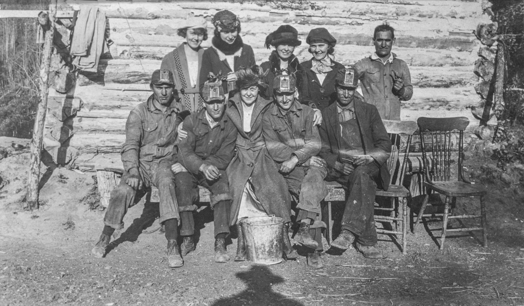 Group photo of coal miners and women. From the Domenico Chiarello fonds, date unknown. Image courtesy of the Provincial Archives of Alberta A10957. Do not reproduce.
