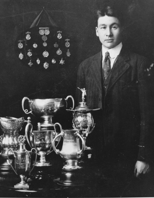 Alex Decoteau with Trophies, City of Edmonton Archives, EA-159-4.