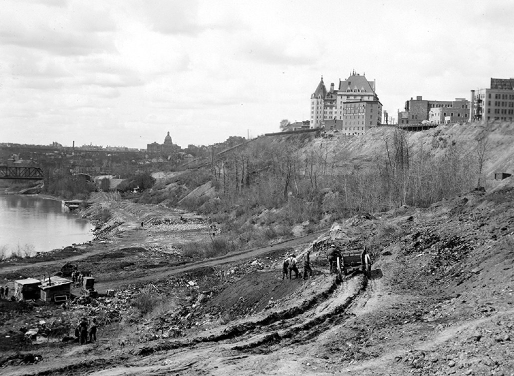 Image of the Grierson Dump with the Hotel MadDonald and the Alberta Legislature in the background, circa 1931. People working in the dump with a wagon are visible in the foreground. Photo courtesy of the City of Edmonton Archives EA-217-2.