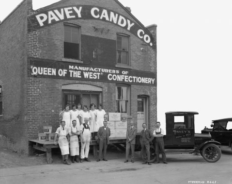 Pavey Candy Company, group photograph of staff standing outside of building, Edmonton, Alberta c. 1924. Original photograph by McDermid Studio. Image courtesy of the Glenbow Archives.