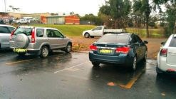 The Queanbeyan Spotlight car park, one outside the lines, the other in a drive way
