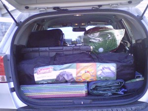 camping gear in the back of an SUV