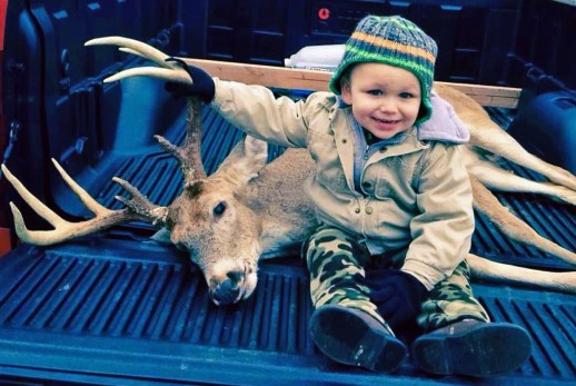 Courtland Kelley (2 yrs old) with his father Richard Kelley's 10-pt buck on Christmas Eve