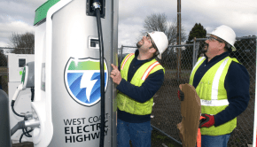 Workers put the finishing touches on installing a plug-in electric vehicle charger that is part of the West Coast Electric Highway.  Image Credit: Columbia-Willamette Clean Cities Coalition.