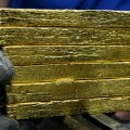 A man carries gold bricks at SJC gold factory in Ho Chi Minh city