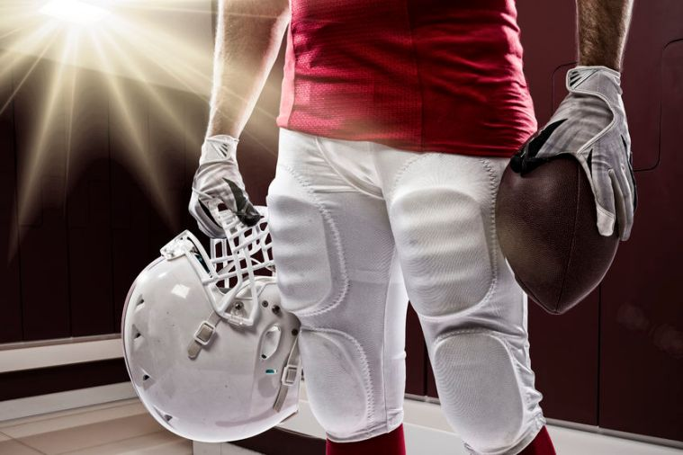 35219287 - football player with a red uniform on a locker roon.