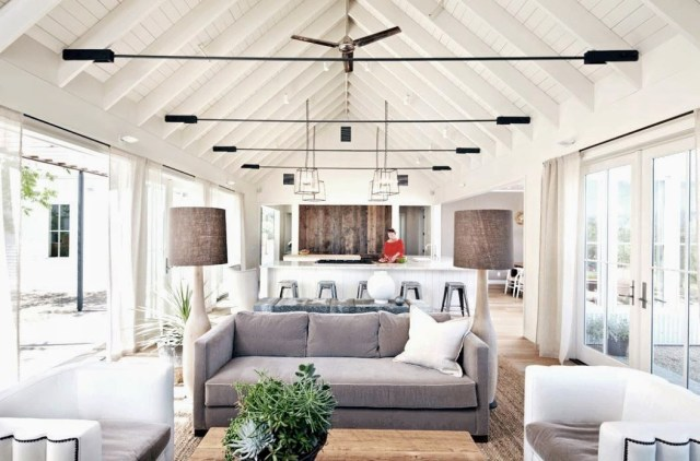 open floor plan living room kitchen pitched ceiling exposed beams
