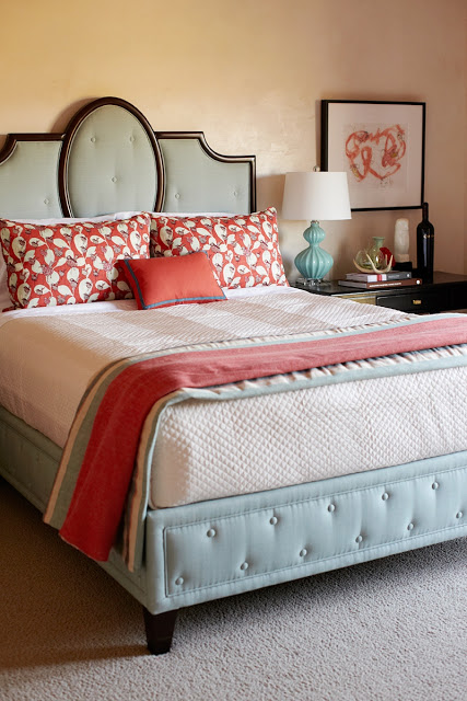 close up of bed with upholstered headboard and side table in the guest bedroom