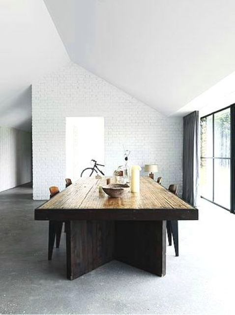 modern dining room wood table white brick wall big glass sliding doors