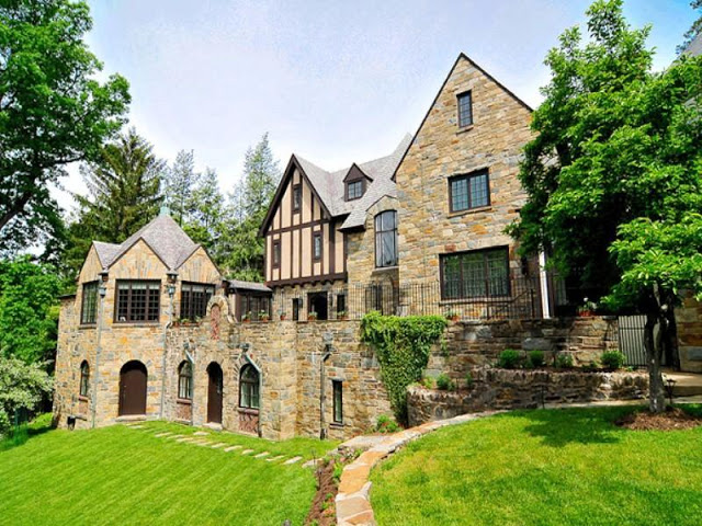 exterior of a stone tudor style estate