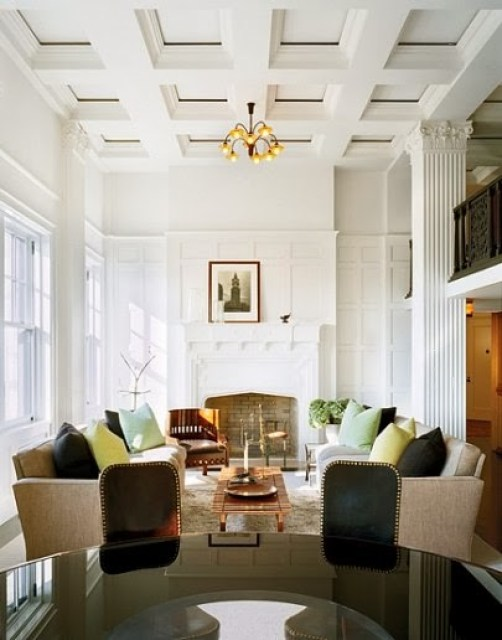 Living room in a New York penthouse with detailed paneling, dueling sofas, large windows with a view of Central Park