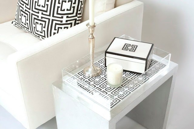 COCOCOZY Lucite Tray. COCOCOZY Lacquer Box and candle on silver table in a white living room