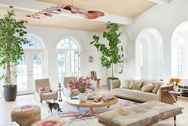 Todd Nickey and Amy Kehoe of Nickey Kehoe's living room in their Malibu home featured in House Beautiful with a large mobile by Stephen Oakes