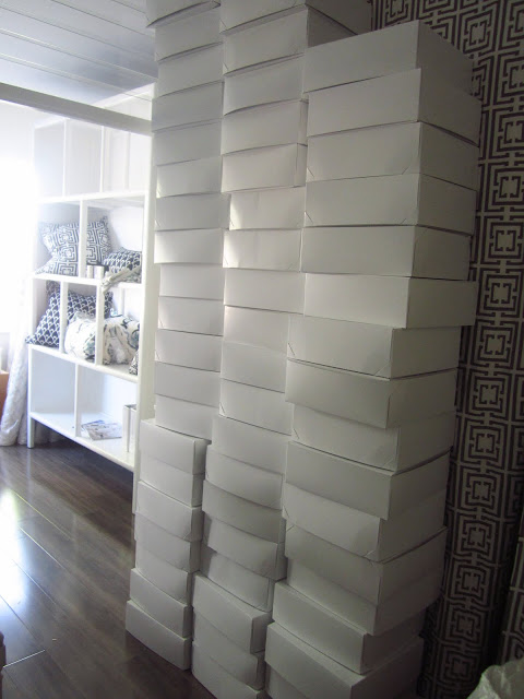 Three giant stacks of white boxes at COCOCOZY HQ