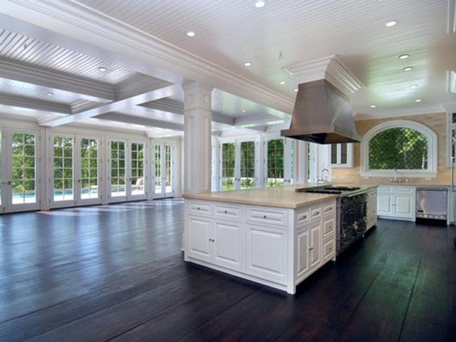 Unstaged kitchen Hamptons dark stained wood floor